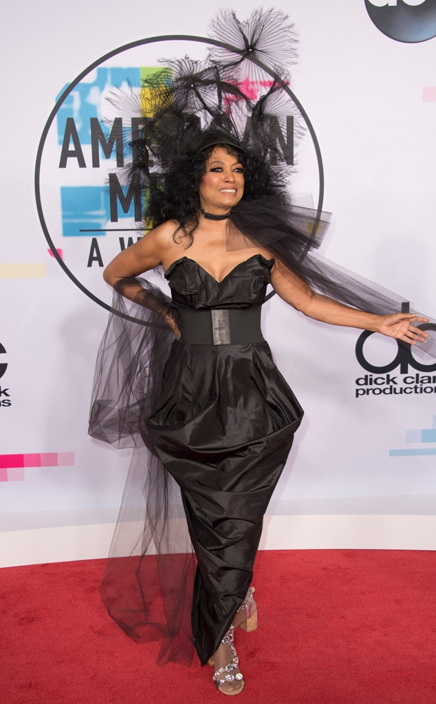 Diana Ross -  Channeling her all-black 1985 AMAs outfit, Ross wore a crinkled black floor-length strapless Vivienne Westwood dress with a massive feathery head ornament to the 2017 awards.