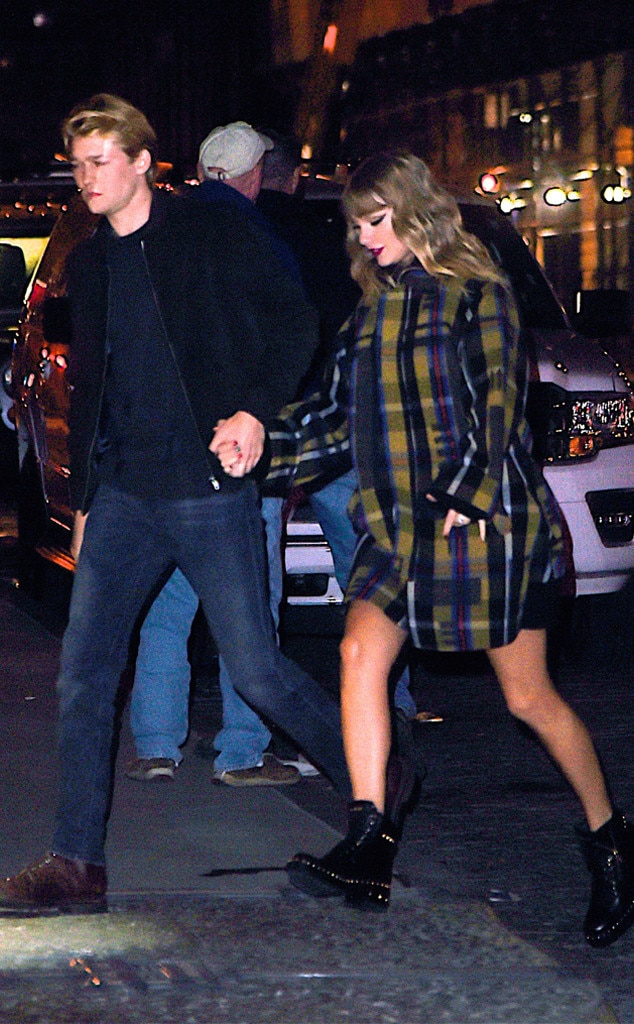 December 2017 -  The couple holds hands as they return to her New York City apartment following her performance at Jingle Ball.