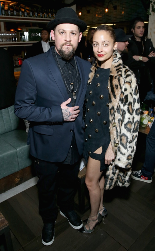 Feeling catty -  Nicole and Joel take a moment for a photo at a party in 2017.