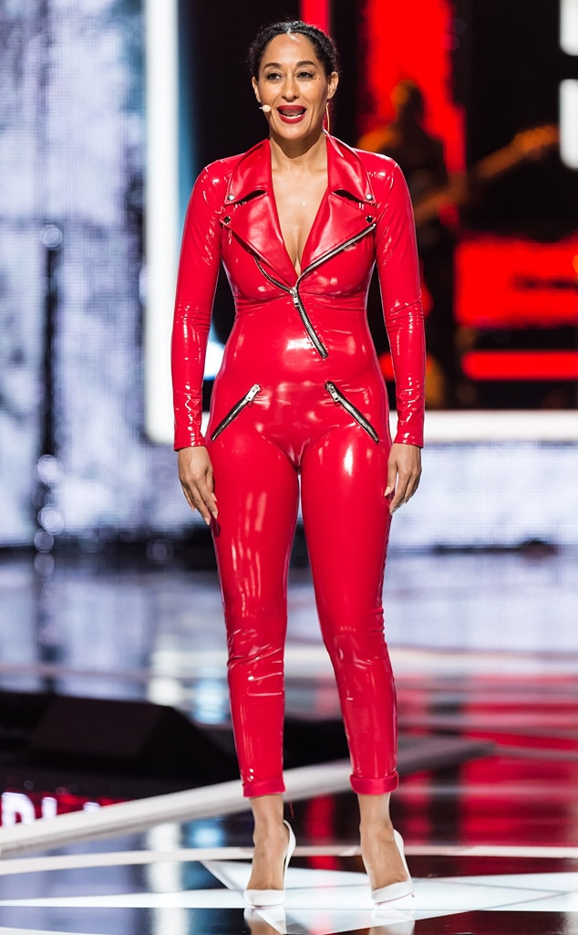 Rockin' Red -  This bright red outfit stands out on the sexy star, complete with some zipper details for a fierce look.