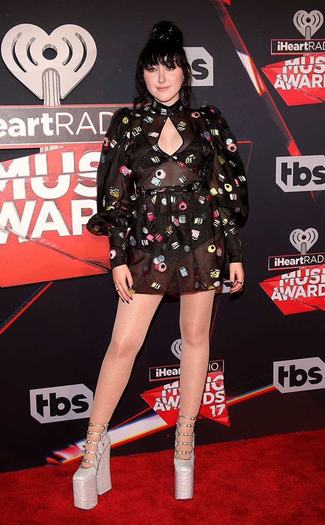 Noah Cyrus -  Noah adds fun and flair to the red carpet with her whimsical Marc Jacobs mini-dress, which features colorful illustrations.