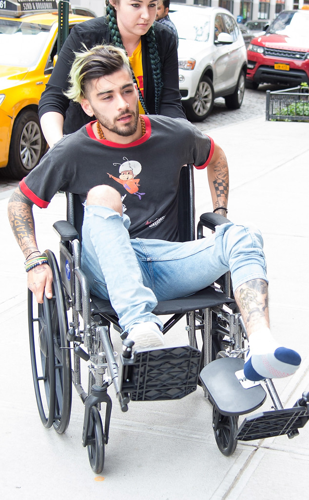 zayn malik spotted in wheelchair after injury e news