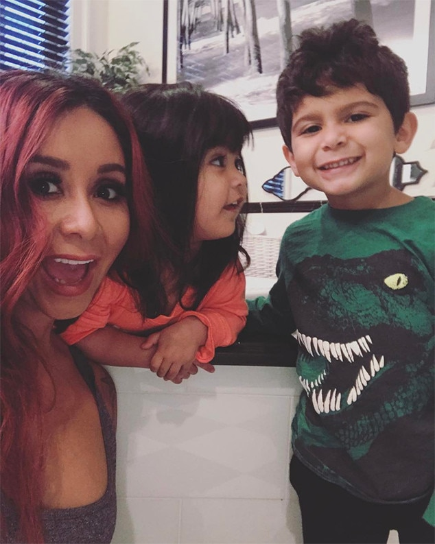Big smiles -  Snooki, Lorenzo and Giovanna were all smiles in a sweet family selfie.