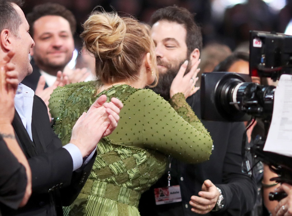 "Wedding Bells -  The ""Hello"" songstress celebrates her Album of the Year win at the 2017 Grammys by smooching her former beau for all to see. During her acceptance speech, Adele refers to Simon as her husband, sparking reports of a secret wedding between the pair."