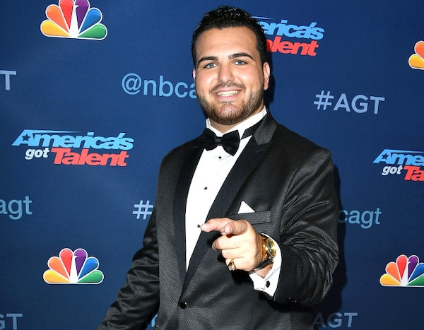 Sal Valentinetti wearing a black suit and a white shirt while pointing his finger to the camera