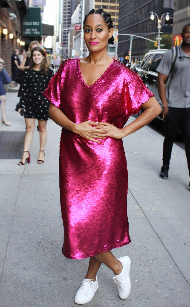 What A Combo -  Doing her part to brighten up the streets on NYC, the  Joan  actress steps out in this show-stopping, sequin dress from JCPenny paired with white sneakers.