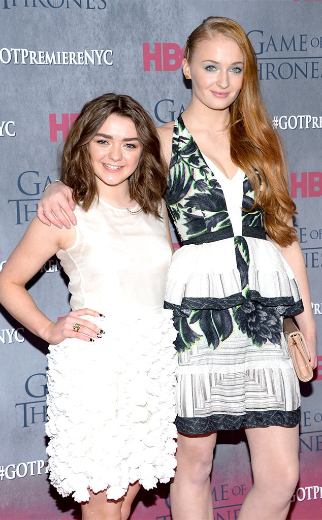 Stark Sisters forever -  Maisie and Sophie, who play Arya Stark and Sansa Stark, stop and smile for the camera on the carpet at the  Game of Thrones  Season 4 premiere in New York in 2014.