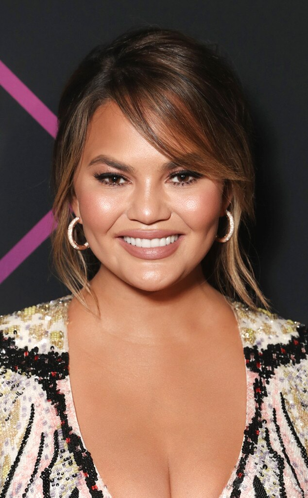 Chrissy Teigen -  This star was radiant with the perfect nude lipstick and rosy cheeks. Then, hairstylist  Glen Coco  on behalf GHD added an effortless updo.