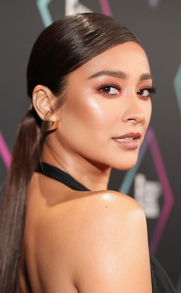 Shay Mitchell -  The  Pretty Little Liars  star's low ponytail is a sleek and sexy—a hairstyle we're stealing this season.