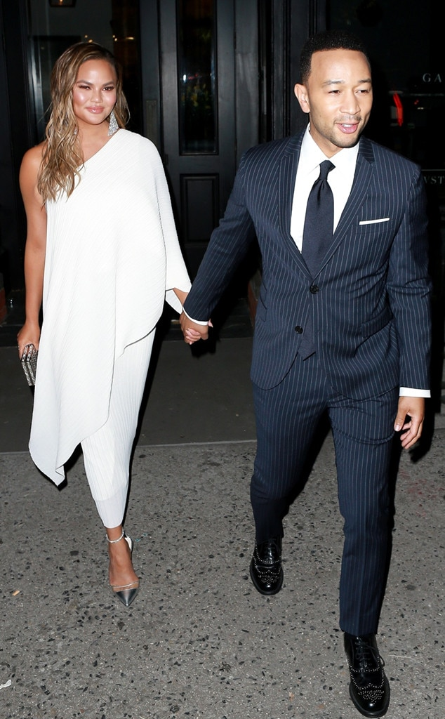 Chrissy Teigen & John Legend -  The fun couple can't hide their love, holding hands on the way to the Glamour Women of the Year Awards.