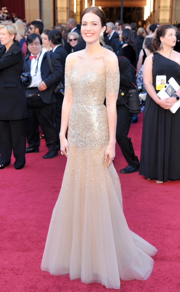 Golden Goddess -  Mandy lit up the Academy Award'sred carpet in this gold sequined Monique Lhuillier mermaid gown.