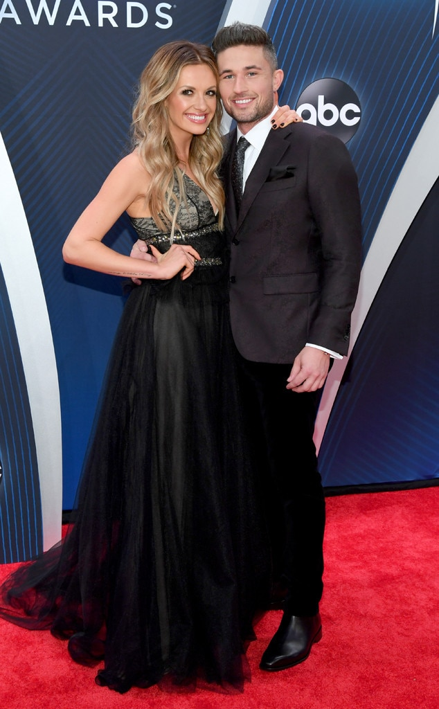 "Carly Pearce & Michael Ray -  Talk about country music couple's goals. The ""Hide the Wine"" darling arrives in a Monique Lhuillier dress with Giuseppe Zanotti shoes for her date night with the ""Get To You"" singer."