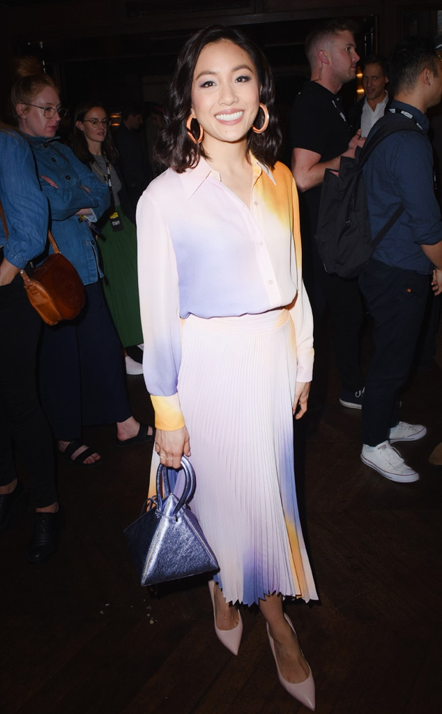Colorful Constance -  The actress wore a matching long-sleeve blouse and pleated skirt paired with pastel pink heels and a metallic purple pyramid bag during the Vulture Festival.