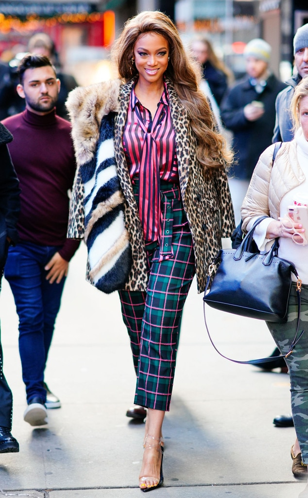 Tyra Banks -  The producer, host and TV personality mixes holiday prints like a pro on the streets of NYC.