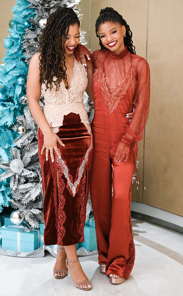 Chloe and Halle Bailey -  Merry and bright for the season, the sister duo opts for coordinating ensembles, marked by lace and red hues, at a girls' night thrown at Tiffany & Co.