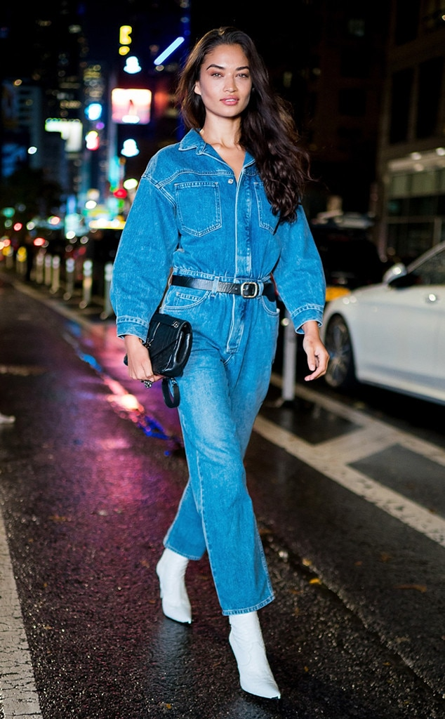 Shanina Shaik -  The model braved the brisk NYC weather in a full-length denim jumpsuit and trendy white pointed-toe boots accessorized with a black belt around her waist and a YSL bag.