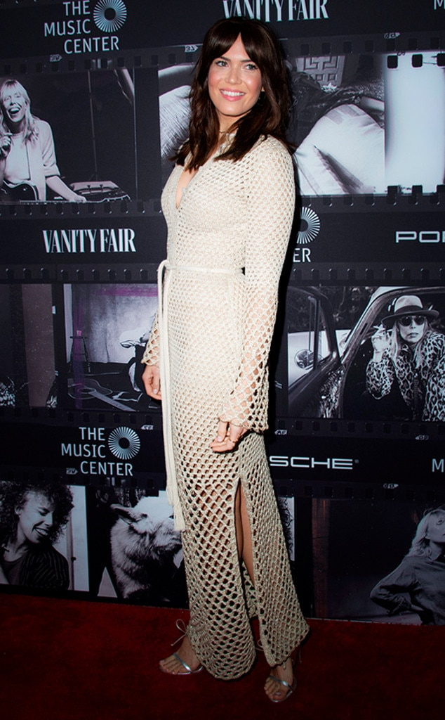 Mandy Moore -  The actress served '70s vibes at Joni Mitchell's birthday celebration in this full-length white crochet dress. To match the vibe, she revealed blunt bangs with a middle part.