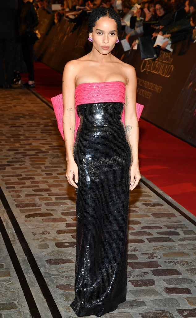 Zoe Kravitz -  The actress made a shining statement in this black sequined Saint Laurent dress that features a neon pink sash along her bust in honor of the world premiere of  Fantastic Beasts: The Crimes Of Grindelwald .