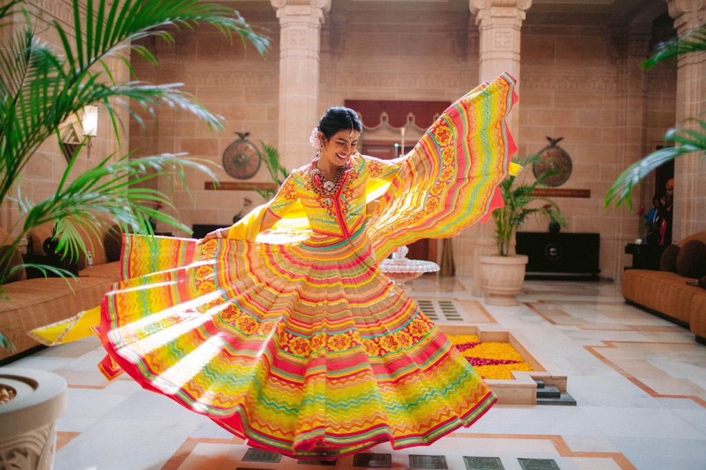 Gorgeous Bride-to-Be -  The actress twirls in her colorful Abu Jani Sandeep Khosla Couture dress.