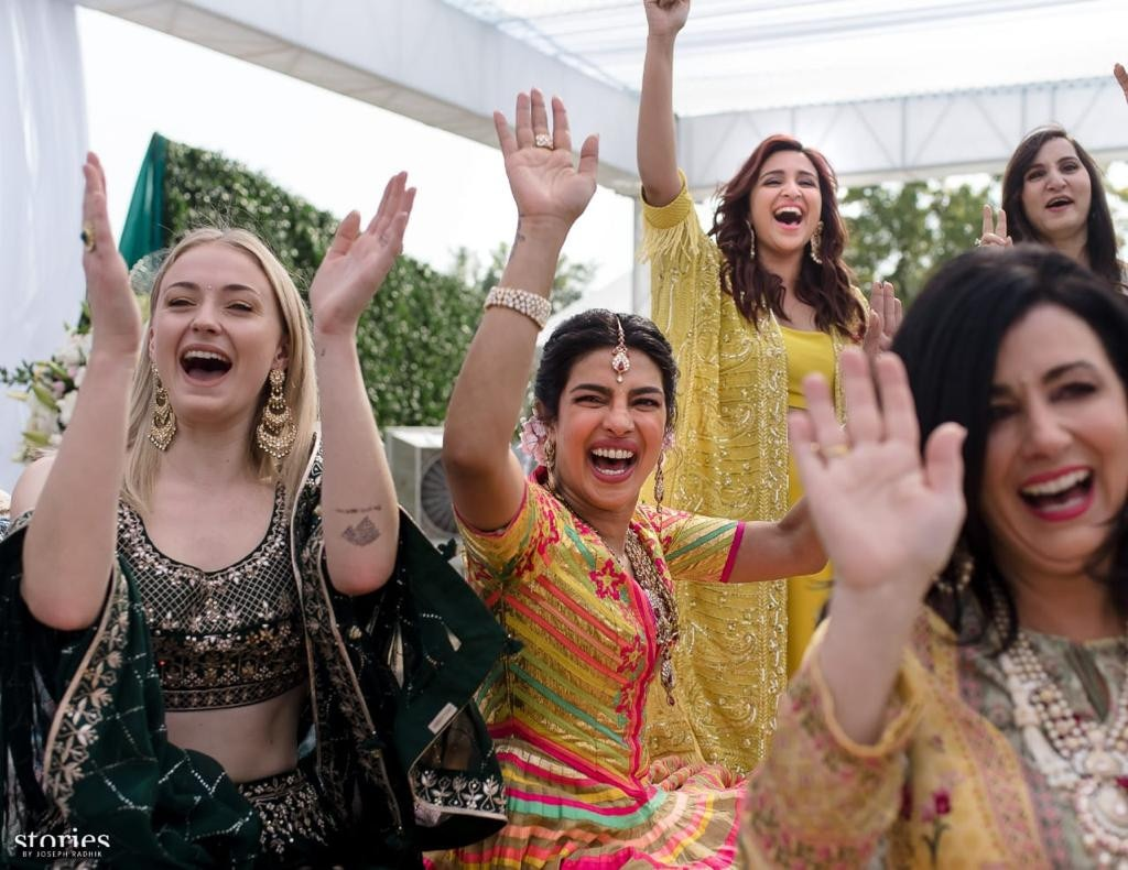 "Girl Power -  The bride cheers with her female guests and wedding party members, including future sister-in-law  Sophie Turner , who is engaged to Nick's brother  Joe Jonas , and cousin  Parineeti Chopra , who wrote on  Instagram , ""THE MEHNDI. The job of us bridesmaids was to make sure the bride was happy and comfortable at all times. But we didn't have to worry about it - coz Nick promised to do it all his life. Welcome to the family Nick jiju!! Im so so happy that the Jonas and Chopra family are now united!!!"""