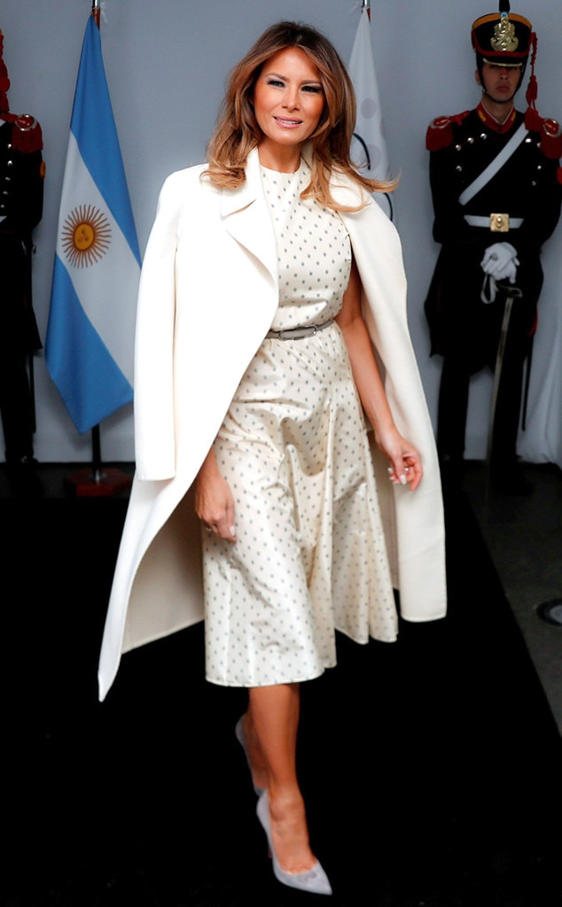 Polka Perfection -  For the G20 Summit in Buenos Aires, Melania wore an all-white ensemble that featured a polka-dot Christian Dior dress, a matching ivory coat and gray suede heels.