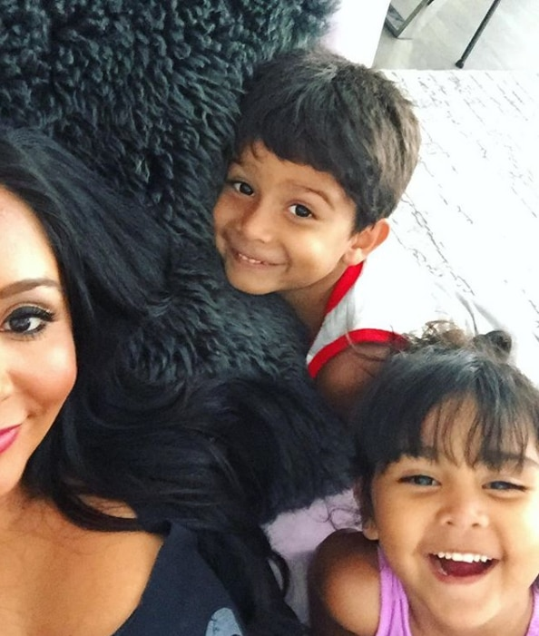 Snooki's soft smiles -  Snooki and her kids smiled at the camera in a silly selfie.