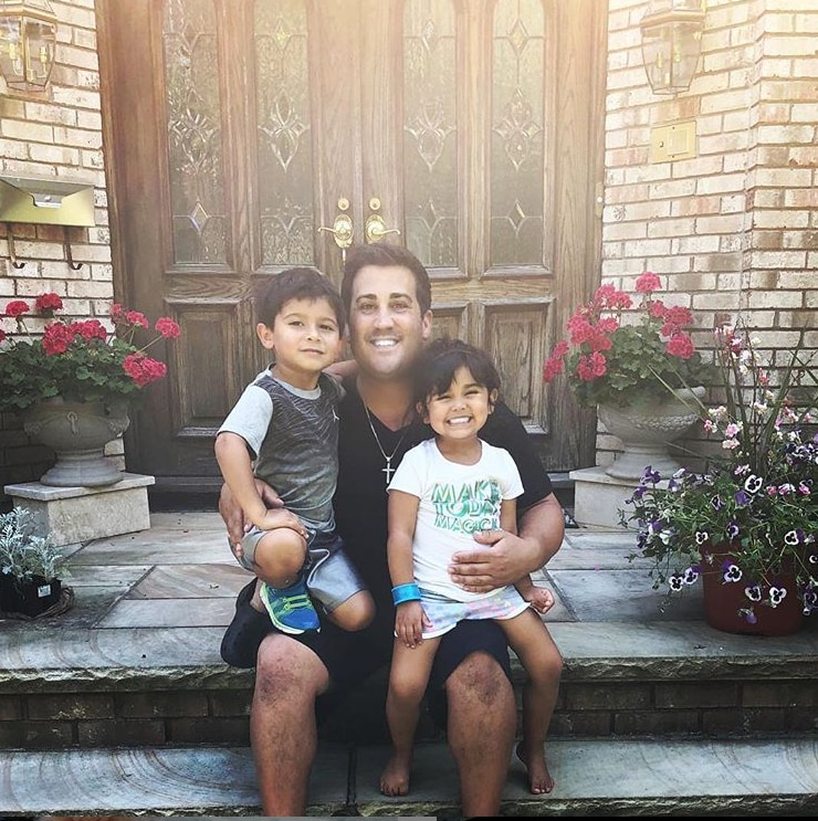 Father's Day joy -  Lorenzo and Giovanna posed with their dad on Father's Day.