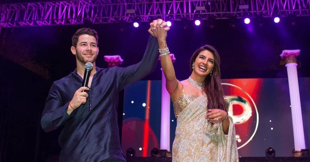 The Bride and Groom (to be) -  Nick and Priyanka appear onstage at their Sangeet party, held before they were wed.