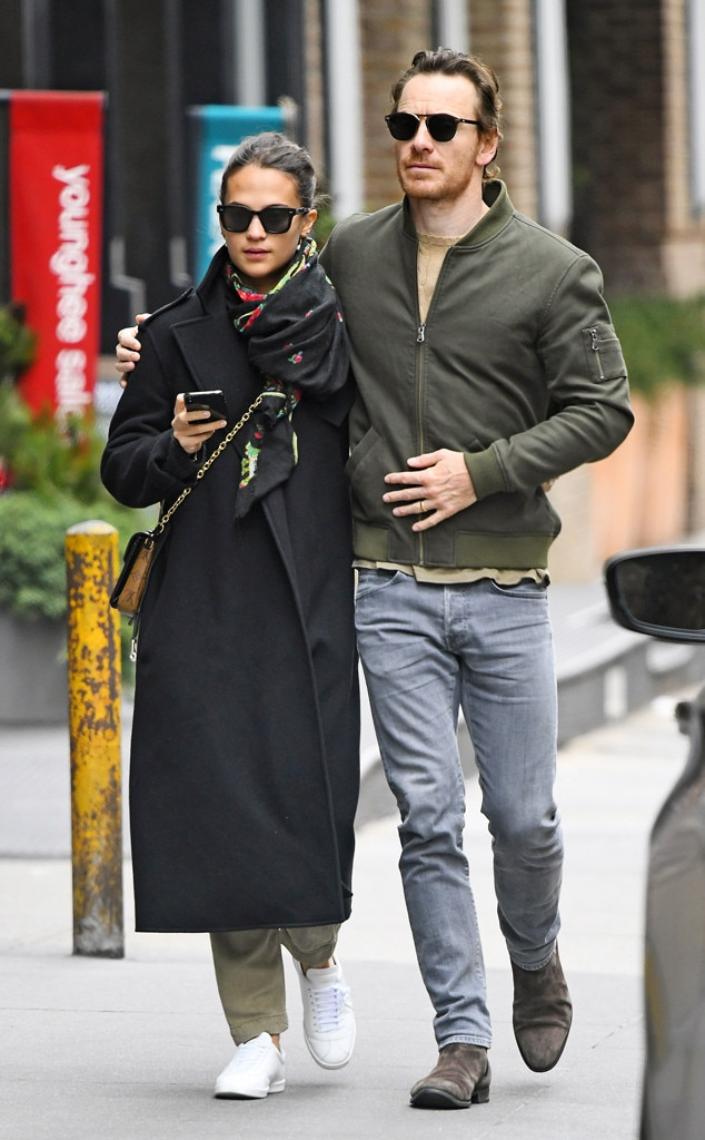 Alicia Vikander and Michael Fassbender -  Strolling along! The couple go on a romantic stroll out in Tribeca as Michael puts his arm around his wife.