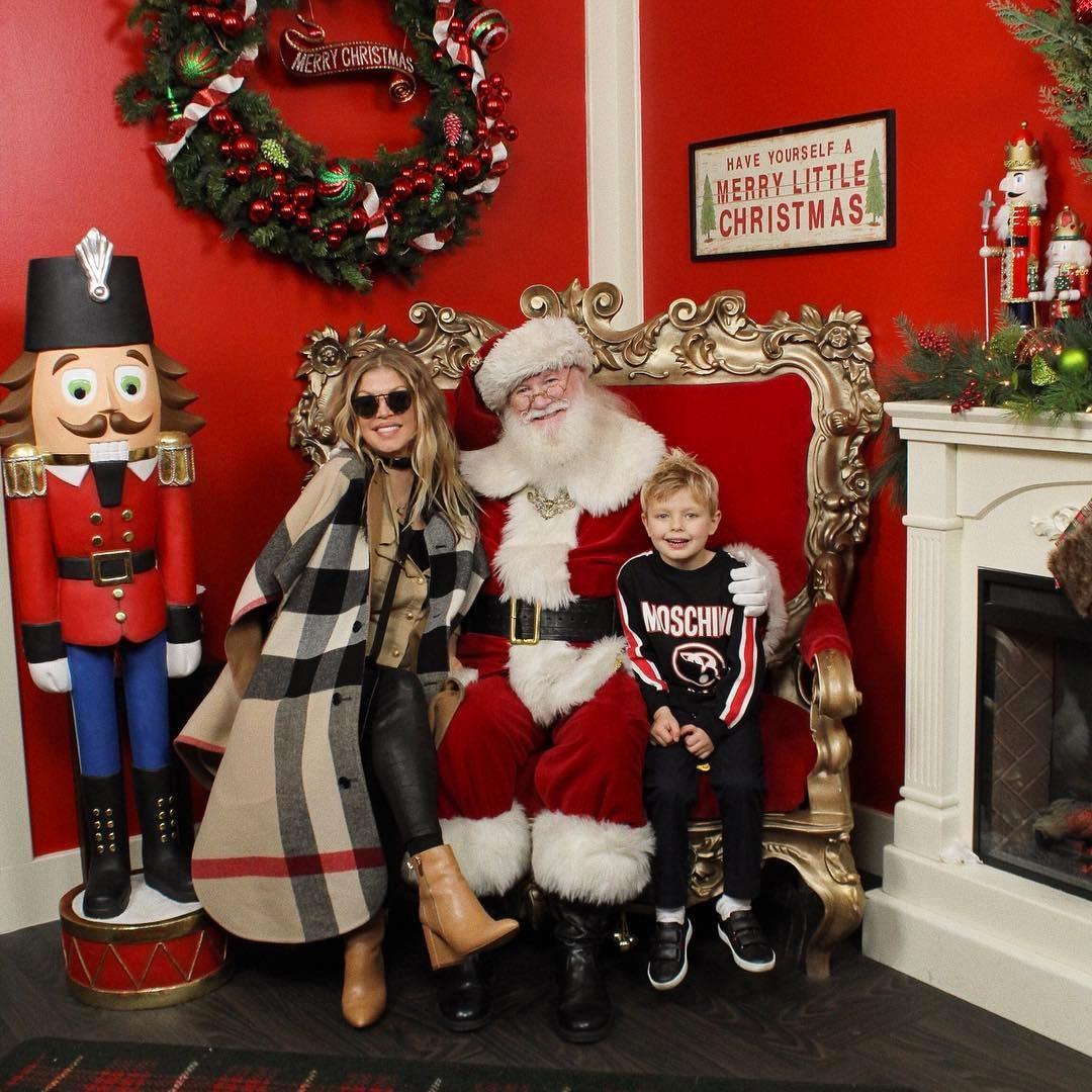 Fergie -  The singer brings son Axl  to meet Santa.