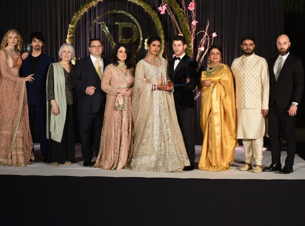 Family Portrait -  The bride and groom pose for a pic with their loved ones at their post-wedding reception in Delhi.