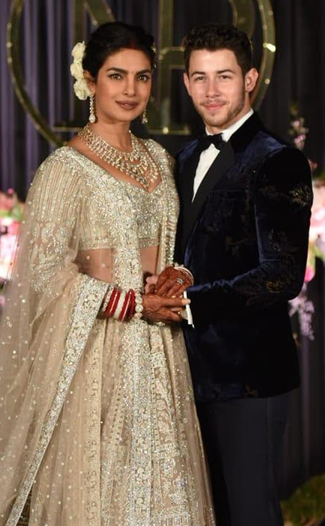 Post-Wedding Reception -  Chopra dazzles in her champagne-colored, beaded ensemble with her new hubby by her side.