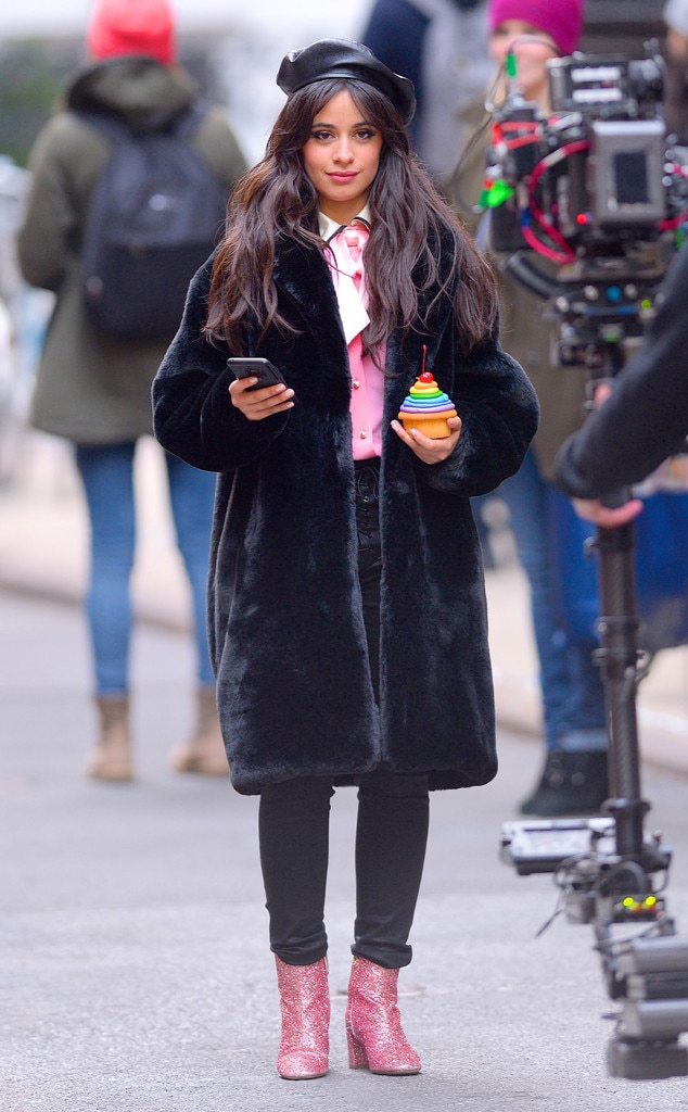 Camila Cabello -  The ' Havana'  singer was seen filming a commercial inManhattan looking stylish and warm while holding a cupcake.