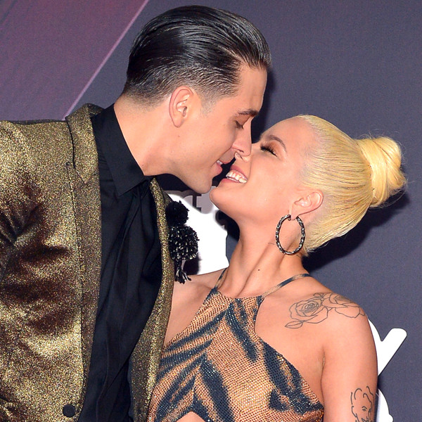 G-Eazy (L) and Halsey arrive at the 2018 iHeartRadio Music Awards which.