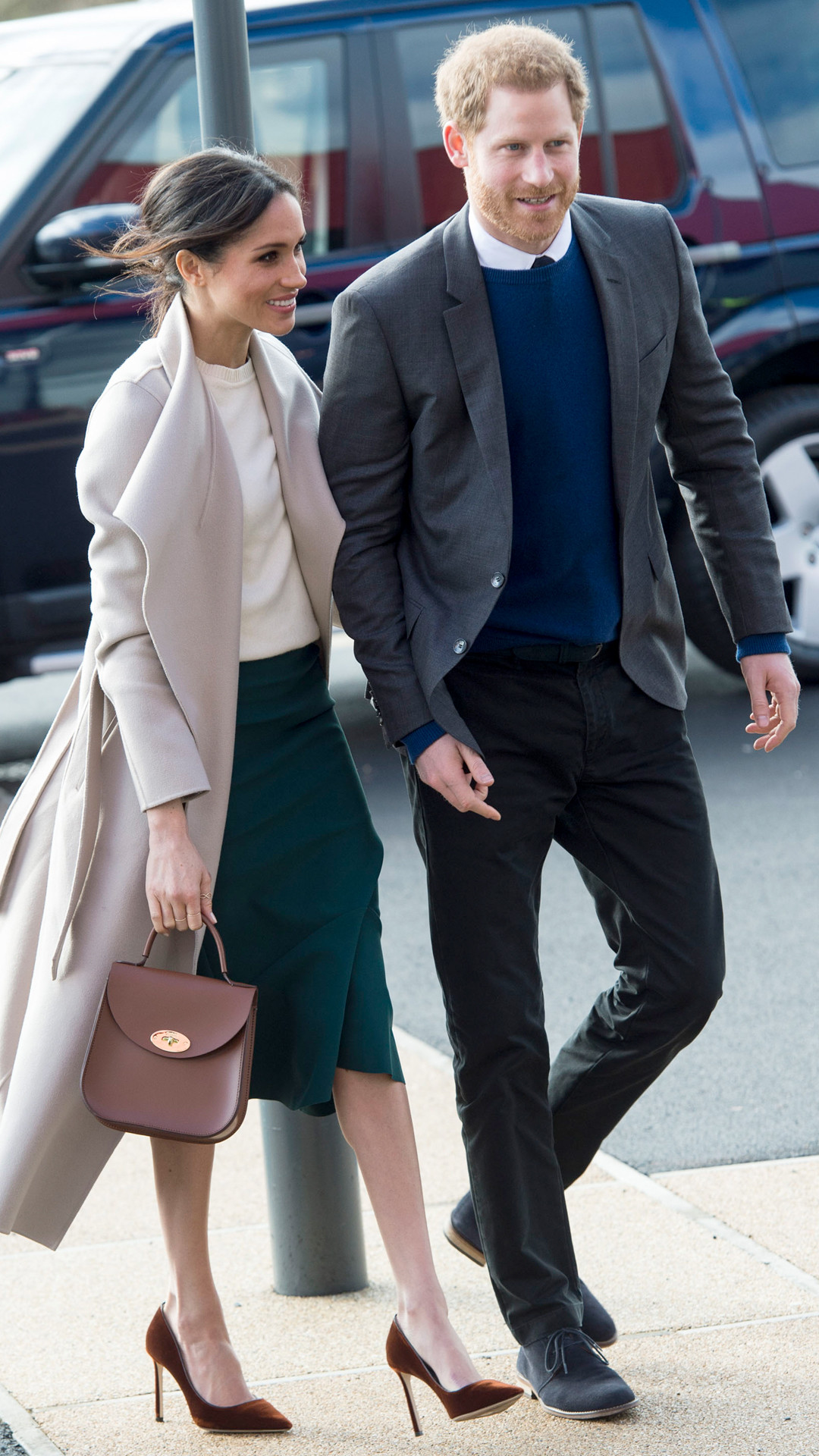 Meghan Markle S Belfast Look Why Her Skirt And Messy Bun Are So