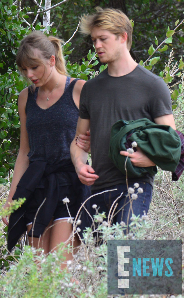 Taylor Swift Holds Joe Alwyn Close During Rare Outing in
