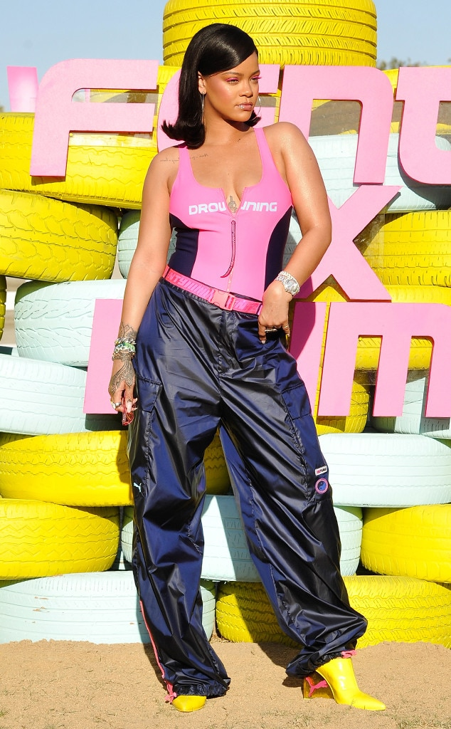 Rihanna -  Despite standing in the hot desert sun, Rihanna kept it cool in a pink bodysuit and parachute pants at the 2018 festival.