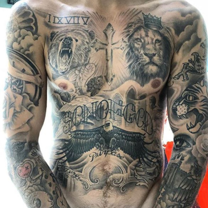 dbba23c22 Justin Bieber Shows Off 100 Hours of Tattoo Work in New Shirtless Selfie |  E! News