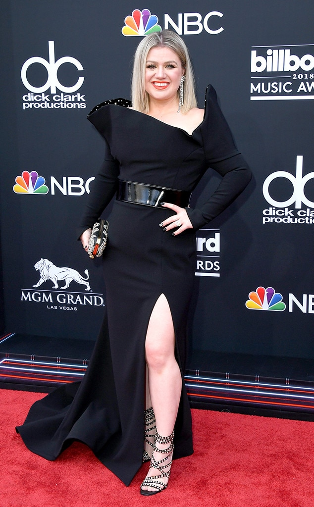 Kelly Clarkson - The Voice  judge and 2018 Billboard Music Awards host  wowed in a long-sleeve, all-black Christian Siriano gown—something a modern-day Evil Queen would don.