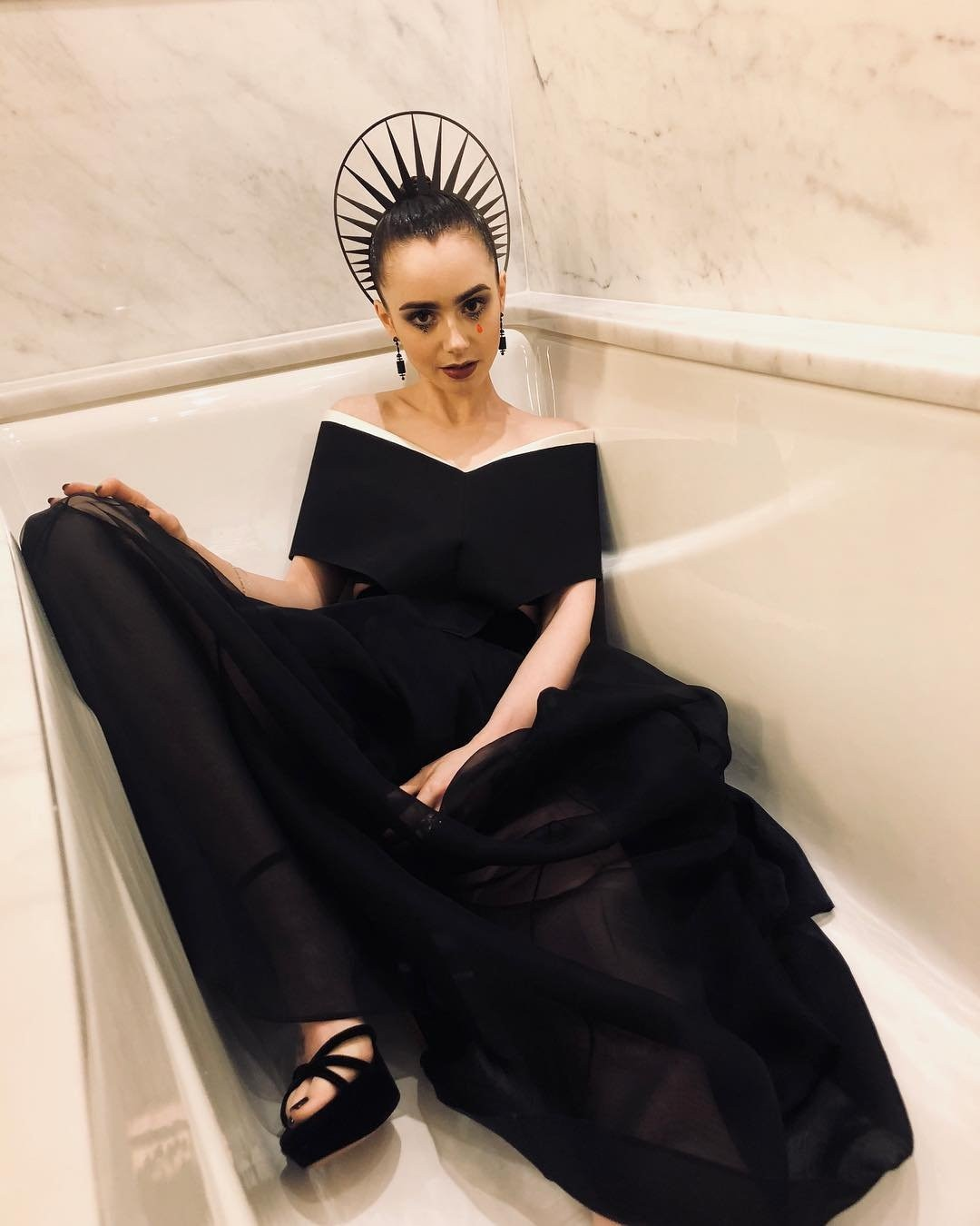 """Taking a Break -  The actress captioned this photo, """"Tell me the truth: should I stay in and take a bath or go out to the after party?"""""""