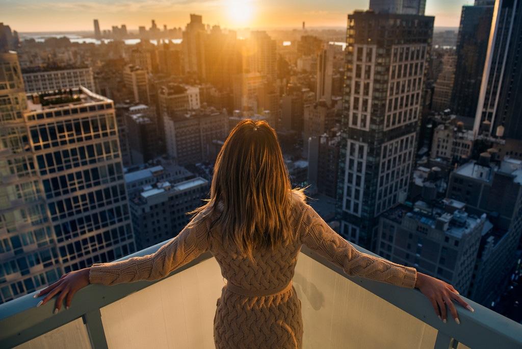 Woman in NYC balcony