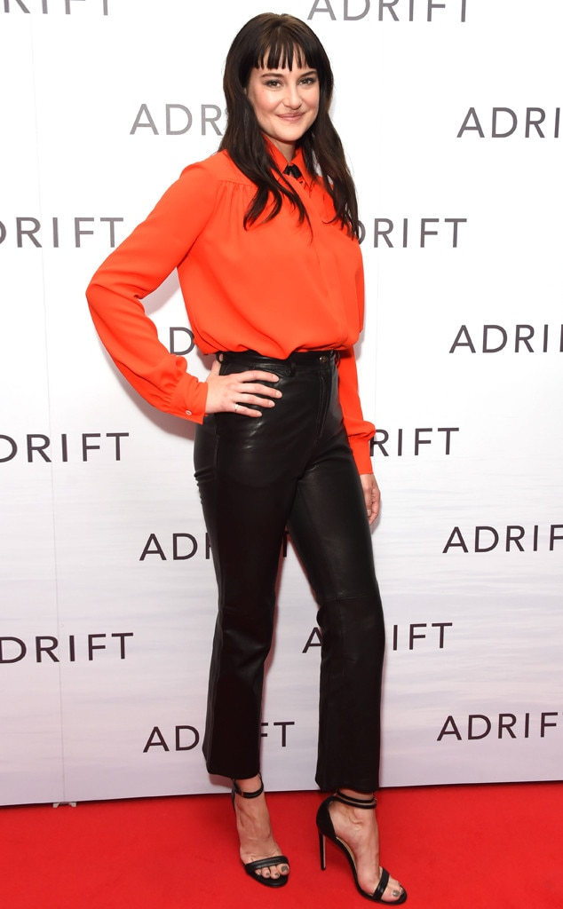 Bright Star -  Actress Shailene Woodley wears a bright orange blouse and black leather pants with a strappy heel.