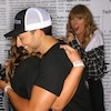 Taylor Swift Looks Shocked as Fans Get Engaged in Front of Her