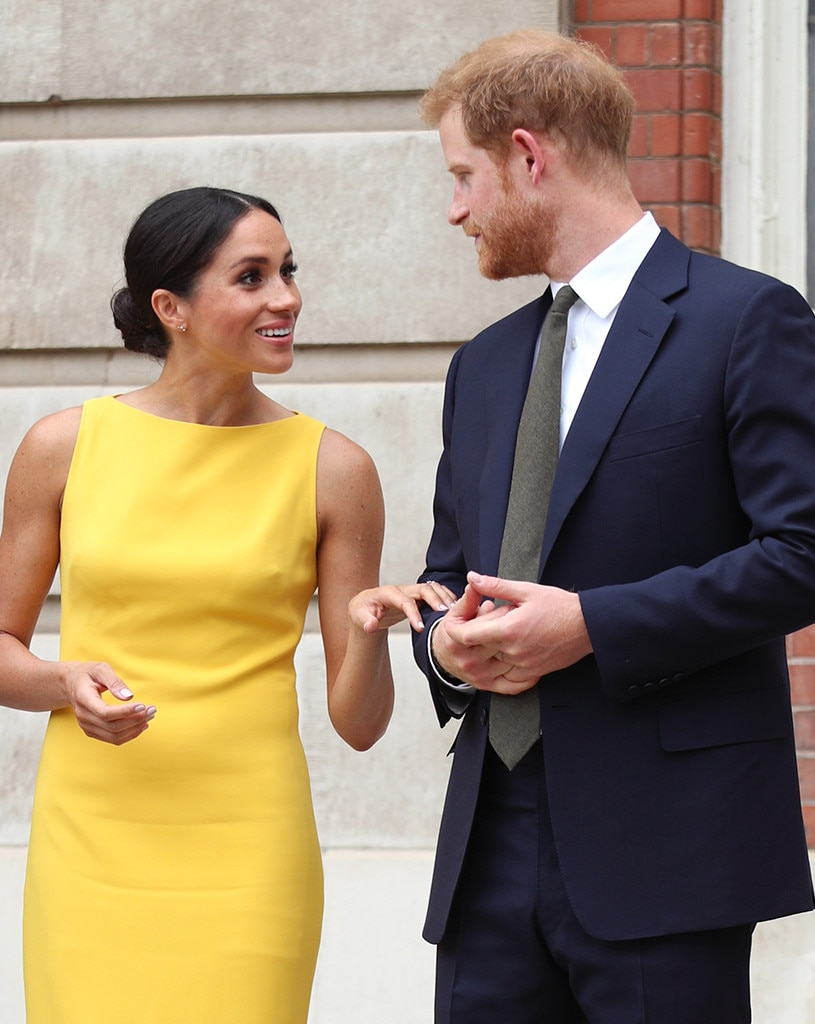 Meghan Markle & Prince Harry -  The royal touch! Thenew duchess looks  sunny and chic  as she joins Prince Harry at the Your Commonwealth Youth Challenge reception in London.