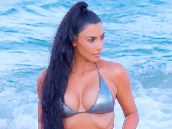 Kim Kardashian Strikes a Pose in Miami in a Metallic Bikini