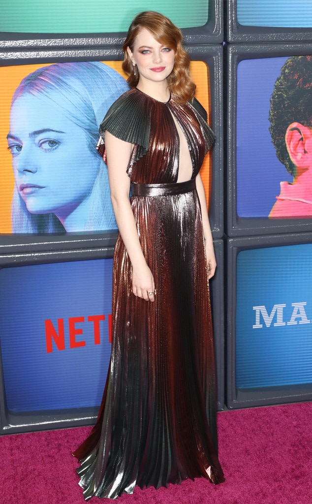Copper Queen - Emma Stone  combines her wavy red hair witha pleated metallic dress to glamorous effect at the premiere of  Maniac  in New York.