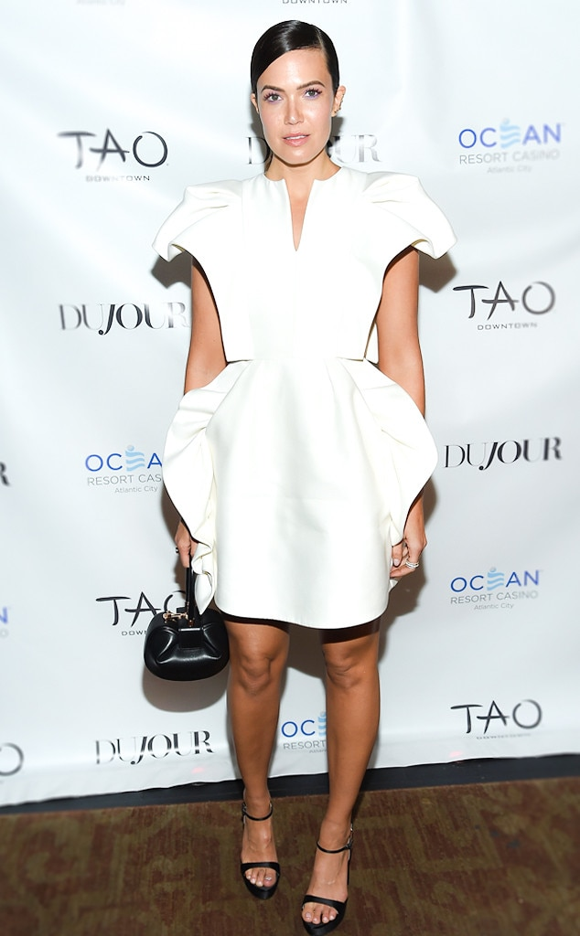 Structured Style -  Mandy looked especially fashionable at The Dujour Magazine Cover party in this sculptural white Dice Kayak cocktail dress paired with black sandals and a Gabriela Hearst bag.