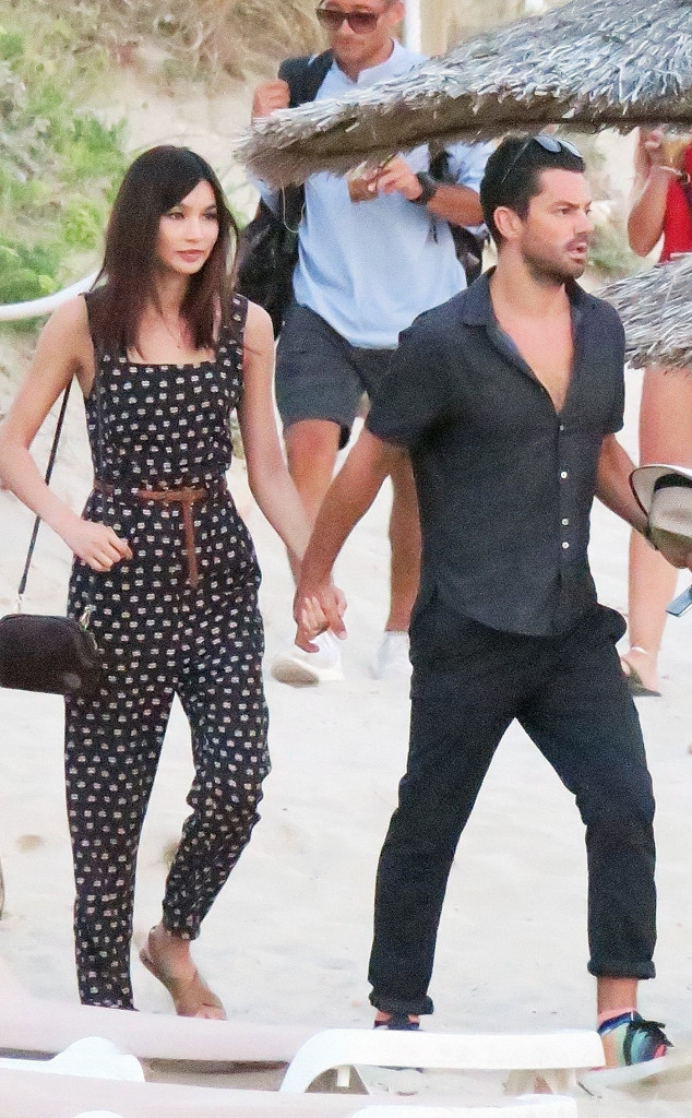 Dominic Cooper And Gemma Chan Holds Hands On Beach In Spain E News