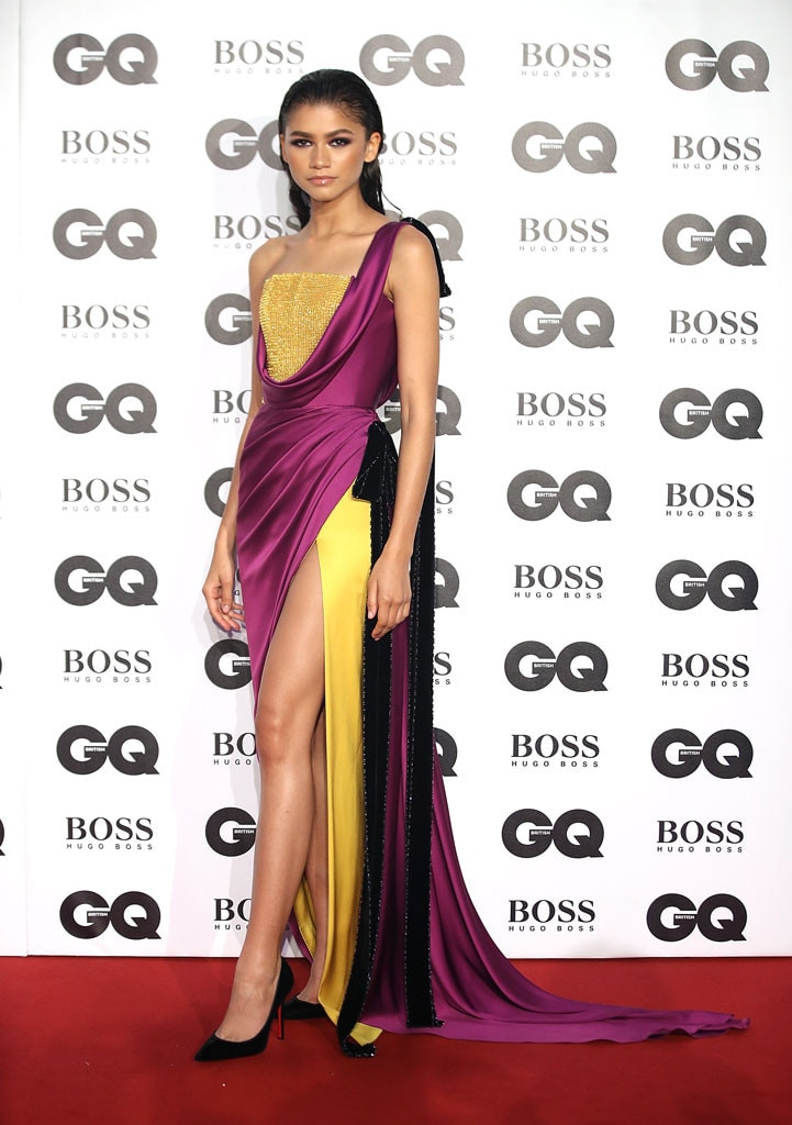 Zendaya -  The actress hit the red carpet in a yellow, black andfusha gown.