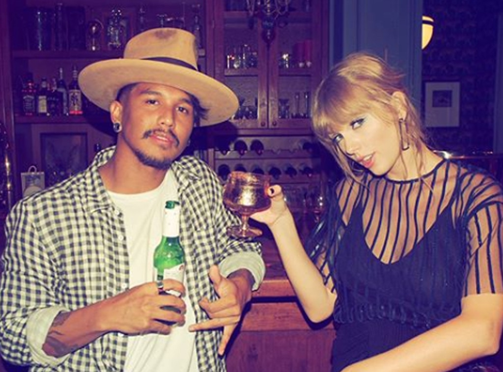 Raise a Glass -  T-Swift gives the camera a sultry look as she poses with one of her backup dancers.